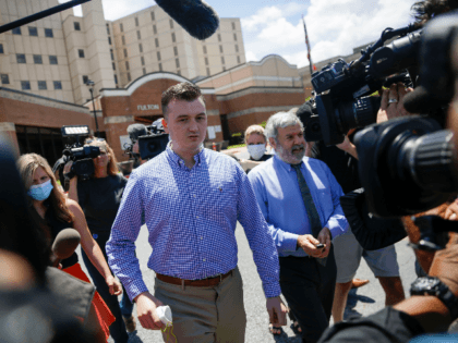 Atlanta Police officer Devin Brosnan is surrounded by media following his release from the Fulton County Jail on Thursday, June 18, 2020, in Atlanta. Authorities have charged Brosnan with four counts, including aggravated assault in the shooting death of Rayshard Brooks. The Fulton County District Attorney said Brosnan stood on …