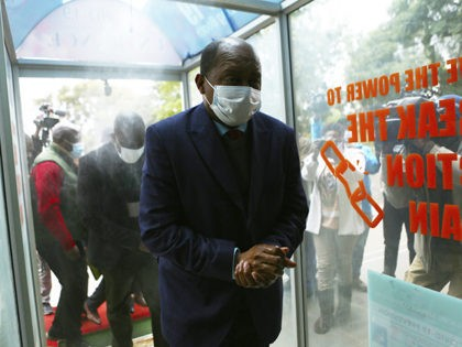 Zimbabwe's Health minister, Obadiah Moyo, arrives at court in Harare, Saturday June 20, 2020. Moyo is facing allegations of illegally awarding a multi- million dollar contract for COVID-19 testing kits, drugs and personal protective equipment to a shadowy company. (AP Photo/Tsvangirayi Mukwazhi)