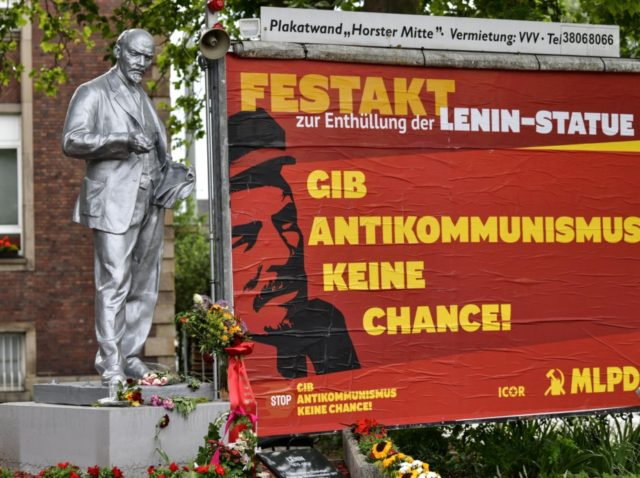 "A controversial Lenin statue is pictured beside a poster reading ""Don't give anti-communism a chance"" in Gelsenkirchen, Germany, on Sunday, June 21, 2020. The statue of the former Soviet leader has been unveiled yesterday by the tiny Marxist-Leninist party MLPD, the installation comes amid global protests against monuments to controversial …"