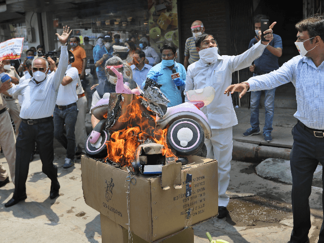 Indian traders burn Chinese products and a poster president Xi Jinping during a protest in New Delhi, India, Monday, June 22, 2020. China said the Galwan Valley high up in the Himalayan border region where Chinese and Indian troops engaged in a deadly brawl this week falls entirely within China, …
