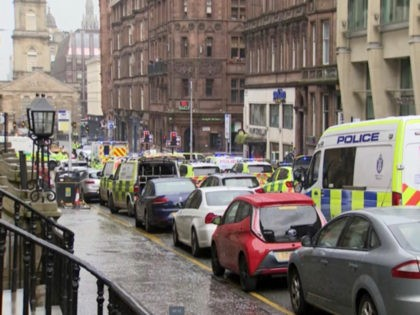 In this image taken from SKY video, emergency services attend the scene of incident in Glasgow, Scotland, Friday June 26, 2020. Police in Glasgow say emergency services are currently dealing with an incident in the center of Scotland's largest city and are urging people to avoid the area. (SKY via …