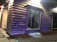 This Friday, June 26, 2020, photo released by the Portland Police Department shows damage after protests calling for an end to racial injustice and accountability for police in Portland, Ore. Some protesters set fire to a police precinct, vandalized businesses and tried to barricade police officers inside their station during …