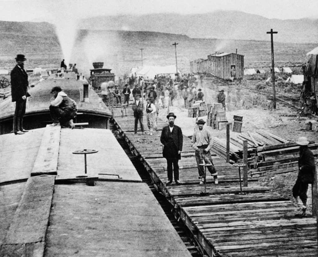 Celebrity Beauty: Workers laying tracks for Central Pacific Railroad conclude for a moment at camp