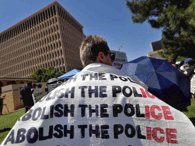 Abolish the police (Matt York / Associated Press)