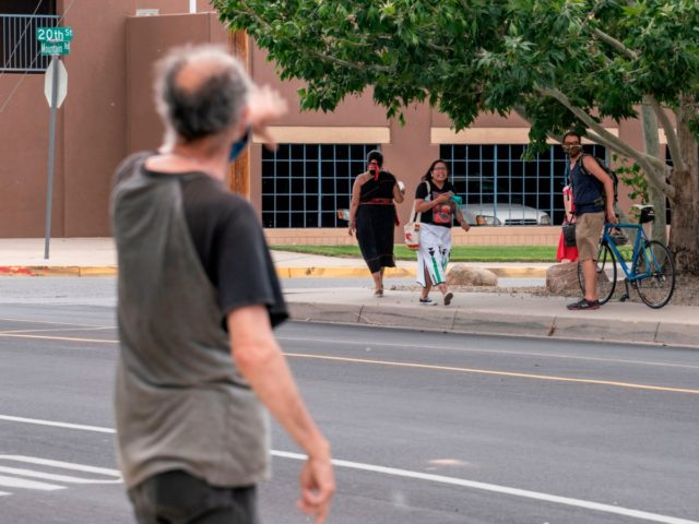 A man who opposed the removal of a statue of conquistador Juan de Onate argues with protesters on June 16, 2020 in Albuquerque, New Mexico after the sculpture of the conquistador was removed. - A man was shot on June 15 as a heavily armed militia group attempted to defend …