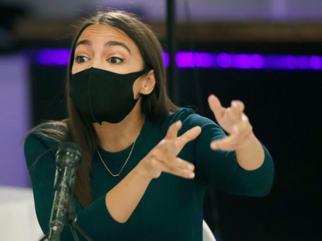 Rep. Alexandria Ocasio-Cortez, D-N.Y., gestures during a debate ahead of New York's June 23 primary election, Wednesday, June 17, 2020, in New York. Three of the four candidates attended. (AP Photo/Kathy Willens)