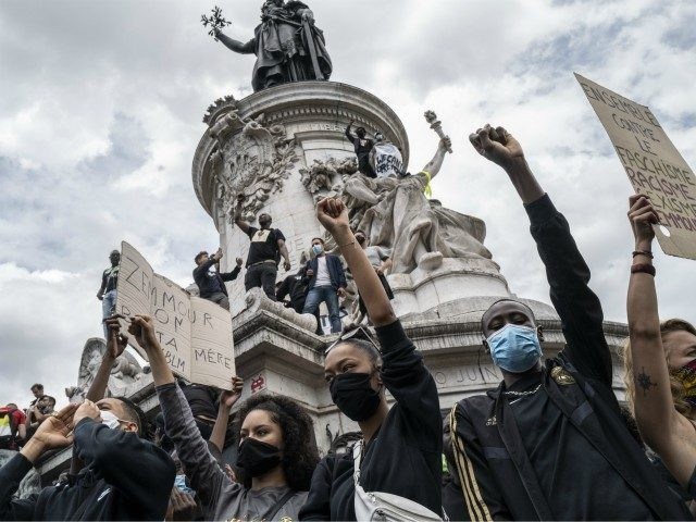 PARIS, FRANCE - JUNE 13: Protesters stand on the monument in Place de la Republique during an antiracism protest on June 13, 2020 in Paris, France. The anti-racism protests here that began with expressions of solidarity with George Floyd, the American man who was killed by police in Minneapolis, have …