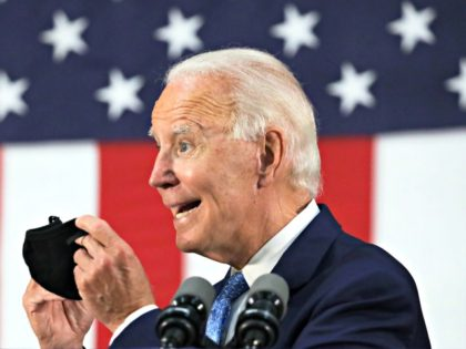 WILMINGTON, DELAWARE - JUNE 30: Democratic presidential candidate, former Vice President Joe Biden holds up a mask as he speaks during a campaign event June 30, 2020 at Alexis I. Dupont High School in Wilmington, Delaware. Biden discussed the Trump Administration's handling of the COVID-19 pandemic. (Photo by Alex Wong/Getty …