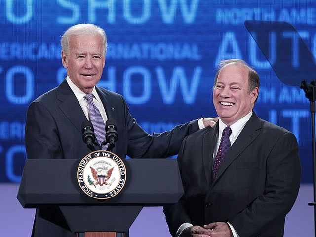 DETROIT, MI - JANUARY 16: U.S. Vice President Joe Biden (left) and Detroit Mayor Mike Duggan stand on stage before the Vice President gives a speech about the future of the American auto industry at the 2014 North American International Auto Show January 16, 2014 in Detroit, Michigan. The 2014 …