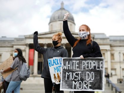 Protesters holding placards attend a demonstration in Trafalgar Square in central London on June 5, 2020, to show solidarity with the Black Lives Matter movement in the wake of the killing of George Floyd, an unarmed black man who died after a police officer knelt on his neck in Minneapolis. …
