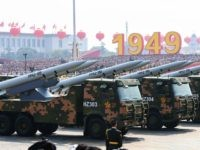 Military vehicles carrying HHQ-9B surface-to-air missiles participate in a military parade at Tiananmen Square in Beijing on October 1, 2019, to mark the 70th anniversary of the founding of the Peoples Republic of China. (Photo by GREG BAKER / AFP) (Photo credit should read GREG BAKER/AFP via Getty Images)