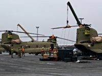 U.S. Technicians prepare helicopters for the transport in Bremerhaven, northern Germany, Sunday Feb. 12, 2017. The U.S. Army has begun unloading dozens of Chinook, Apache and Black Hawk helicopters at the northern German port of Bremerhaven, to be moved to the Bavarian town of Illesheim, Germany. Some of them will …