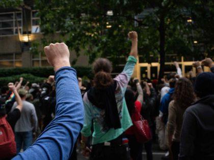 Chop fists Seattle (David Ryder / Getty)