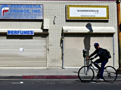 Closed shopfronts in what would be a normally busy fashion district in Los Angeles, California on May 4, 2020. - California governor Gavin Newsom earlier today announced the gradual reopening of the state later this week as dismal US employment figures are expected with the release of figures Friday May …
