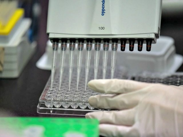 A lab technician works on an antibody test for the MERS coronavirus in South Korea on March 11. Ed Jones/AFP via Getty Images