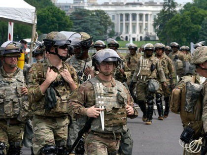 WASHINGTON, DC - JUNE 06: National Guard members deploy near the White House as peaceful protests are scheduled against police brutality and the death of George Floyd, on June 6, 2020 in Washington, DC. People are expected to descend on Washington to participate in peaceful protests in the wake of …