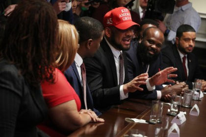WASHINGTON, DC - FEBRUARY 27: David Harris Jr. wears a 'Keep America Great' hat while attending a meeting with U.S. President Donald Trump and other African American supporters in the Cabinet Room at the White House February 27, 2020 in Washington, DC. The president talked about the economic advances African …