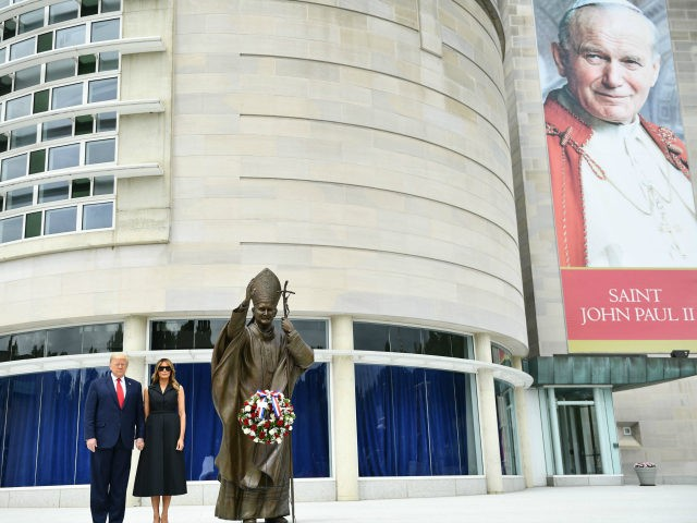 US President Donald Trump and First Lady Melania Trump visit the Saint John Paul II National Shrine, to lay a ceremonial wreath and observe a moment of remembrance under the Statue of Saint John Paul II on June 2, 2020 in Washington,DC. (Photo by Brendan Smialowski / AFP) (Photo by …