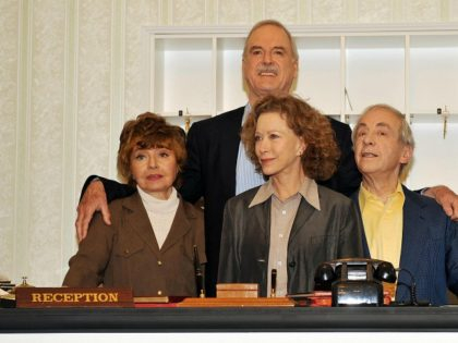 "(From L to R) Actors Prunella Scales, John Cleese, Connie Booth and Andrew Sachs pose for photographs as the original cast members of the British comedy programme ""Fawlty Towers"" attend a press conference in central London, on May 6, 2009. The event was held to promote a new documentary marking …"