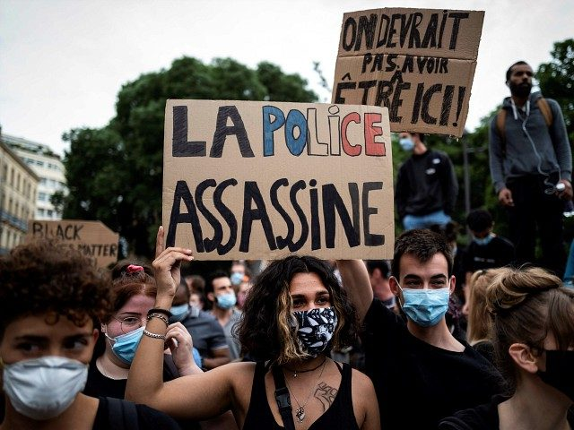 A demonstrator holds up a placard reading 'The police kills' in Toulouse, southern France, on June 3, 2020 during a protest against police violence and in memory of late US citizen George Floyd as well as late French citizen Adama Traore. - At least 2,000 people gathered on Wednesday night …