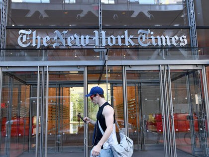 A man walks by the New York Times building on September 6, 2018 in New York. - A furious Donald Trump called September 5, 2018 for the unmasking of an anonymous senior official who wrote in the New York Times that top members of his administration were undermining the president …