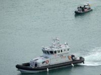 """DOVER, ENGLAND - DECEMBER 29: UK Border Force boats patrol Dover Harbour as British immigration minister Caroline Nokes visits UK Border force staff at Dover Marina on December 29, 2018 in Dover, England. The growing number of migrants attempting to cross the English Channel has been declared a """"major incident"""" …"""