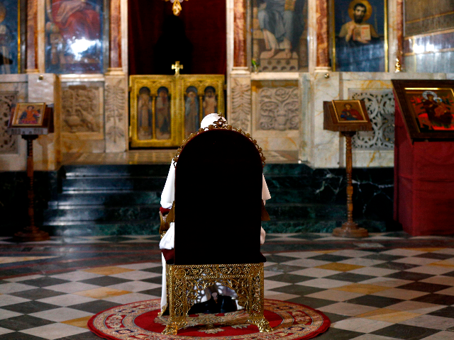 Pope Francis sits in prayer before the throne of Saint Cyril and Methodius at Alexander Nevski Cathedral in Sofia on May 5, 2019. - Pope Francis urged Bulgarians to open their hearts and doors to refugees as he began a visit to the European Union's poorest country, where the main Orthodox Church snubbed holding joint prayers with the pontiff. Prime Minister Boyko Borisov met Francis at the airport, with the government welcoming how the visit has put the former communist country, which joined the EU in 2007, and the Balkans in the international spotlight. (Photo by YARA NARDI / POOL / AFP) (Photo credit should read YARA NARDI/AFP via Getty Images)