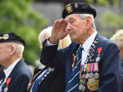 ALREWAS, STAFFORDSHIRE - JUNE 06: Veterans attend a commemoration service at The National Memorial Arboretum on June 06, 2019 in Alrewas, Staffordshire. The Duke of Cambridge will give a speech, lay a wreath and meet veterans following the service. Veterans and their families are gathering to commemorate the 75th anniversary …