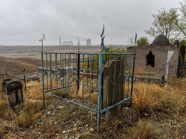 This photo taken on September 10, 2019 shows a general view of a large Muslim cemetery on the outskirts of Urumqi, the regional capital of Xinjiang. - China is destroying burial grounds where generations of Uighur families have been laid to rest, leaving behind human bones and broken tombs in …
