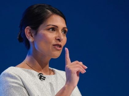 MANCHESTER, ENGLAND - OCTOBER 01: Home Secretary, Priti Patel addresses the delegates on the third day of the Conservative Party Conference at Manchester Central on October 1, 2019 in Manchester, England. Despite Parliament voting against a government motion to award a recess, Conservative Party Conference still goes ahead. Parliament will …