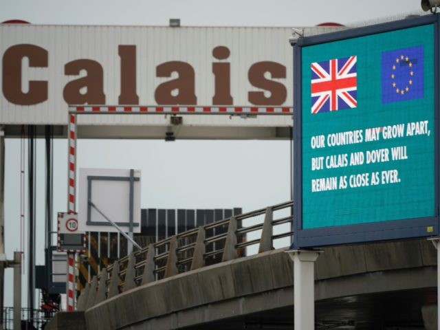 """CALAIS, FRANCE - FEBRUARY 02: A digital information screen at the Calais Ferry terminal declares that """"Our Countries May Grow Apart, But Calais and Dover Will Remain As Close As Ever"""" on February 02, 2020 in Calais, France. The United Kingdom and Northern Ireland has exited the European Union. A …"""