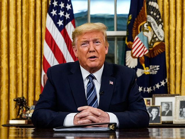 TOPSHOT - US President Donald Trump addresses the Nation from the Oval Office about the widening novel coronavirus (Covid-19) crisis in Washington, DC on March 11, 2020. - President Donald Trump announced on March 11, 2020 the United States would ban all travel from Europe for 30 days starting to …