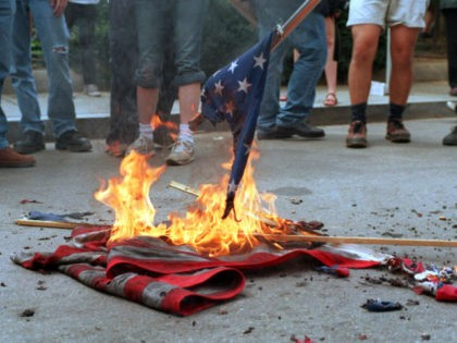 (FILES): This 20 April 2002 file photo shows demonstrators burning US flags in front of the World Bank headquarters during a protest against the International Monetary Fund - World Bank spring meetings in Washington, DC. The US Senate began debate 26 June 2006 on a constitutional amendment banning destruction and …