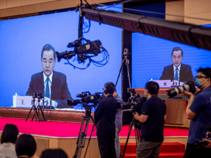 China's Foreign Minister Wang Yi speaks during his online video link press conference during the National People's Congress (NPC) at the media centre in Beijing on May 24, 2020. (Photo by NICOLAS ASFOURI / AFP) (Photo by NICOLAS ASFOURI/AFP via Getty Images)