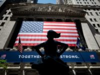The New York Stock Exchange (NYSE) is pictures on May 26, 2020 at Wall Street in New York City. - Wall Street stocks surged early Tuesday on optimism about coronavirus vaccines as the New York Stock Exchange resumed physical floor trading for the first time since late March. About 30 …