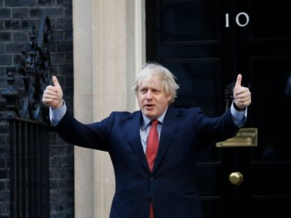 "Britain's Prime Minister Boris Johnson participates in a national ""clap for carers"" to show thanks for the work of Britain's NHS (National Health Service) workers and other frontline medical staff around the country as they battle with the novel coronavirus pandemic, outside 10 Downing Street in London on May 28, …"