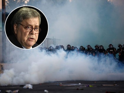 (INSET: U.S. Attorney General William Barr) Police in riot gear block a road near the 5th police precinct following a demonstration to call for justice for George Floyd, a black man who died while in custody of the Minneapolis police, on May 30, 2020 in Minneapolis, Minnesota. - Clashes broke …