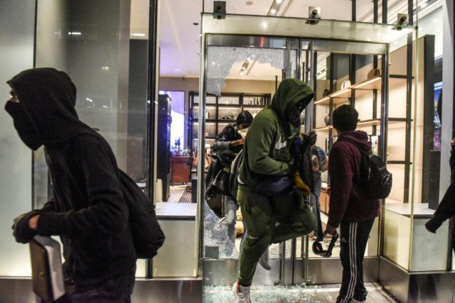 EW YORK, NY - MAY 31: People vandalize a Coach store on May 31, 2020 in New York City. Major cities across the United States have seen increased protests against police brutality and civil unrest since the death of George Floyd while in Minneapolis police custody. (Photo by Stephanie Keith/Getty …