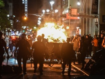 NEW YORK, NY - MAY 31: Protesters set a dumpster on fire on May 31, 2020 in New York City. Major cities across the United States have seen increased protests against police brutality and civil unrest since the death of George Floyd while in Minneapolis police custody. (Photo by Stephanie …
