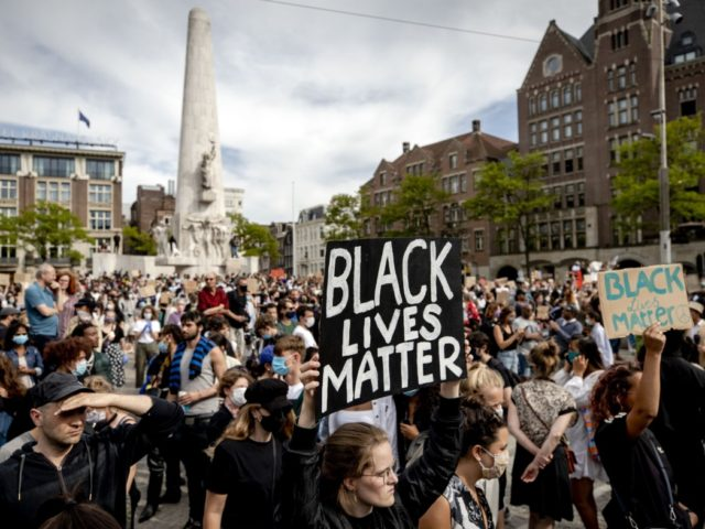 Protesters demonstrate on June 1, 2020 in Amsterdam, to protest against the police killing of unarmed black man George Floyd in the USA. - The United States has erupted into days and nights of protests, violence, and looting, following the death of George Floyd after he was detained and held …
