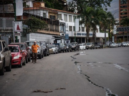 CARACAS, VENEZUELA - JUNE 01: A long line of cars awaiting to put gas in an international prices gas station on June 1, 2020 in Caracas, Venezuela. After 77 days, Maduro Administration eases the restrictions against COVID-19, allowing certain activities to reopen. From today, an official limit has been set …