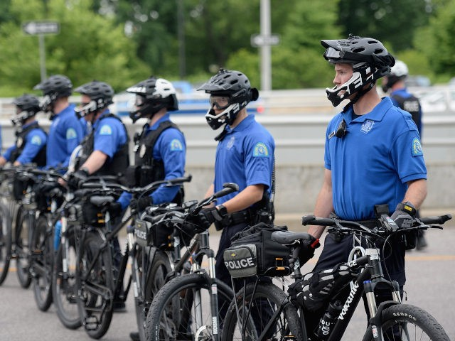 ST LOUIS, MO - JUNE 01: St. Louis City Bike Patrol Officers mobilize as protesters demonstrate against police brutality and the death of George Floyd through downtown St. Louis on June 1, 2020 in St Louis, Missouri. Protests continue to be held in cities throughout the country over the death …