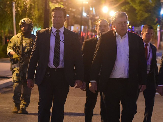 US Attorney General William Barr walks around downtown Washington, DC during curfew on June 1, 2020. - Police fired tear gas outside the White House late Sunday as anti-racism protestors again took to the streets to voice fury at police brutality, and major US cities were put under curfew to …