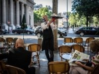 A waiter works at the terrasse of a restaurant in Paris on June 2, 2020, as cafes and restaurants reopen in France, while the country eases lockdown measures taken to curb the spread of the COVID-19 (the novel coronavirus). (Photo by Martin BUREAU / AFP) (Photo by MARTIN BUREAU/AFP via …