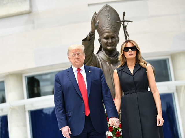 US President Donald Trump and First Lady Melania Trump visit the Saint John Paul II National Shrine, to lay a ceremonial wreath and observe a moment of remembrance under the Statue of Saint John Paul II on June 2, 2020 in Washington,DC. (Photo by Brendan Smialowski / AFP) (Photo by BRENDAN SMIALOWSKI/AFP via Getty Images)