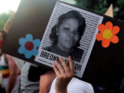 A demonstrator holds a sign with the image of Breonna Taylor, a black woman who was fatally shot by Louisville Metro Police Department officers, during a protest against the death George Floyd in Minneapolis, in Denver, Colorado on June 3, 2020. - US protesters welcomed new charges brought Wednesday against …