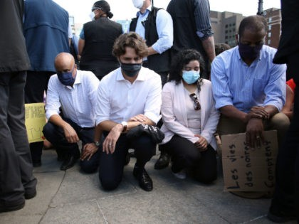 Canadian Prime Minister Justin Trudeau (2nd L) takes a knee during in a Black Lives Matter protest on Parliament Hill June 5, 2020 in Ottawa, Canada. - Canadian Prime Minister Justin Trudeau appeared at a loss for words on June 2, pausing for 20 seconds when pressed for this thoughts …