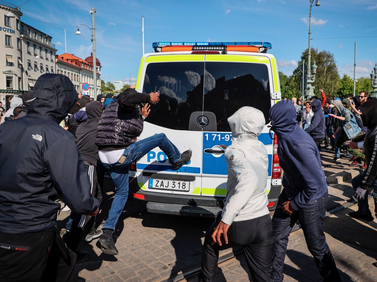 Demonstrators attack a police car during a anti-racism demonstration on June 7, 2020 in Gothenburg, Sweden, in solidarity with protests raging across the US over the death of George Floyd, an unarmed black man who died during an arrest on May 25. (Photo by Adam IHSE / TT News Agency / AFP) / Sweden OUT (Photo by ADAM IHSE/TT News Agency/AFP via Getty Images)