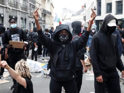Protesters demonstrate during an anti-racism protest, in Brussels, on June 7, 2020, as part of a weekend of 'Black Lives Matter' worldwide protests against racism and police brutality in the wake of the death of George Floyd, an unarmed black man killed while apprehended by police in Minneapolis, US. (Photo …