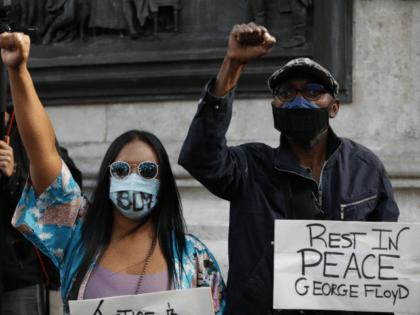 People wearing face masks raises their fist to protest in place de la Republique in Paris, on June 9, 2020, during a demonstration against racism and police brutality in the wake of the death of George Floyd, an unarmed black man killed while apprehended by police in Minneapolis. (Photo by …